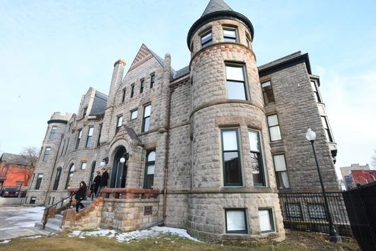 Historic Scott Mansion, with Detroit skyline to the south, which has been renovated into market-rate rental apartments in the Cass Corridor. The $6 million project leverages federal and state historic tax credits.