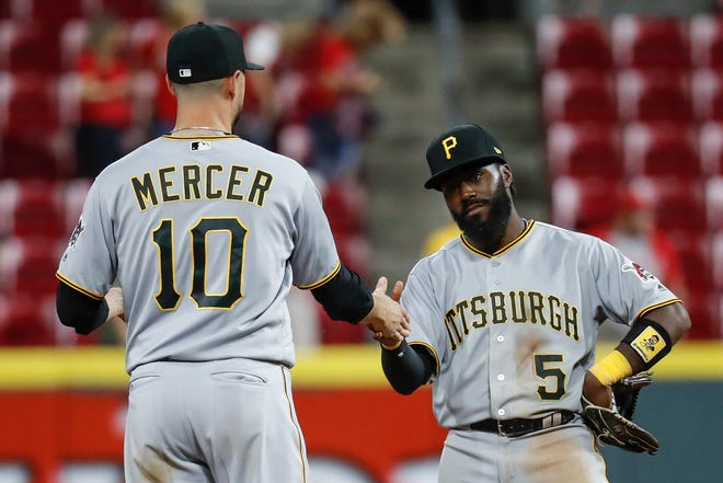 Josh Harrison and Jordy Mercer celebrate after a Pirates win over the Reds in May 2018.