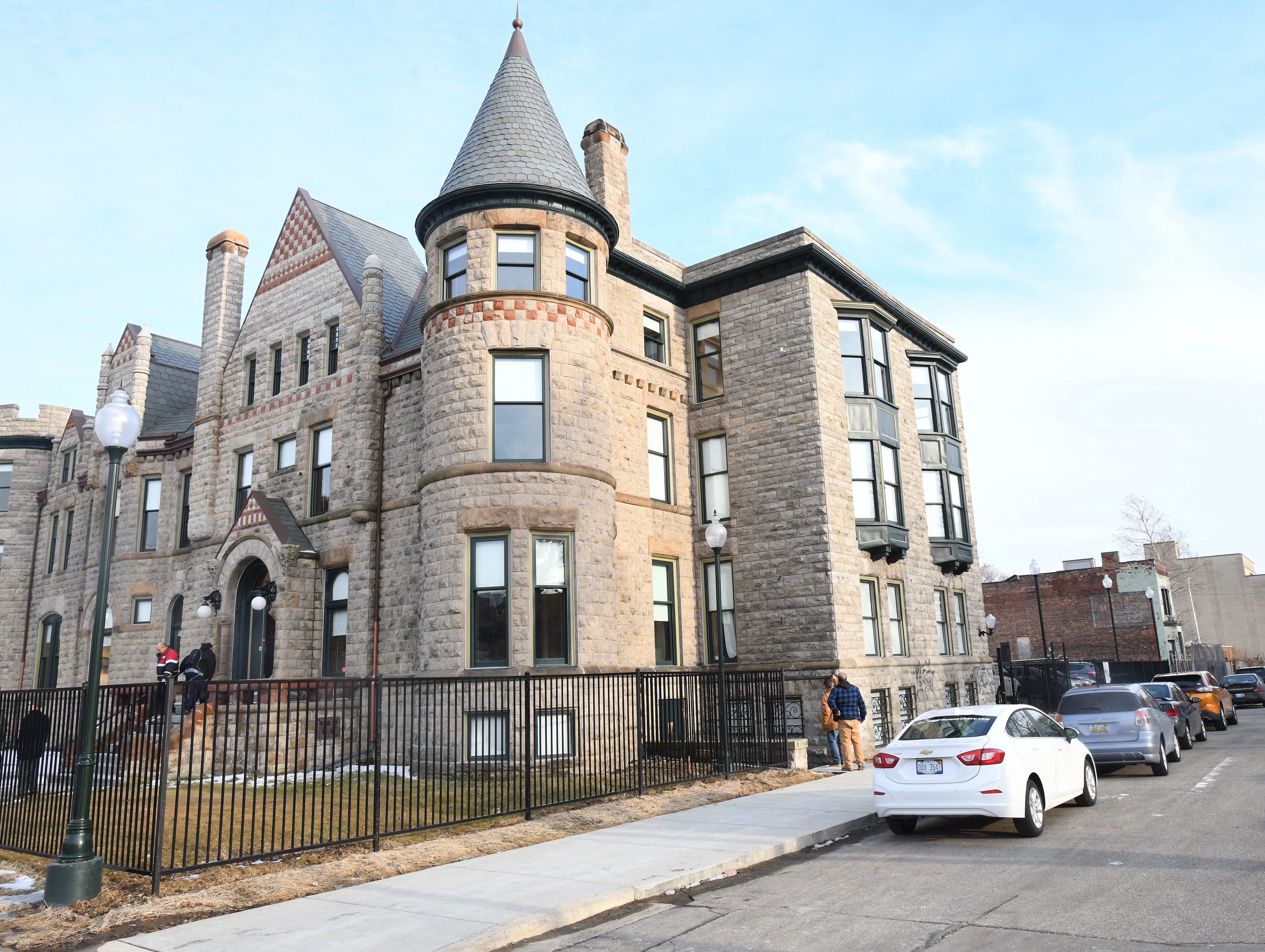 Guests tour historic Scott Mansion which has been renovated into market-rate rental apartments in the Cass Corridor.