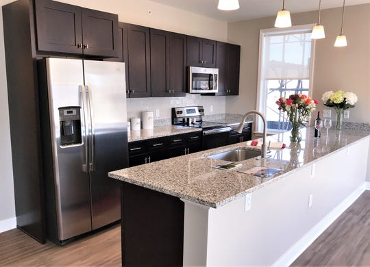 New apartments in a mixed-use building on West Water Street in Elmira feature spacious kitchens and other amenities.