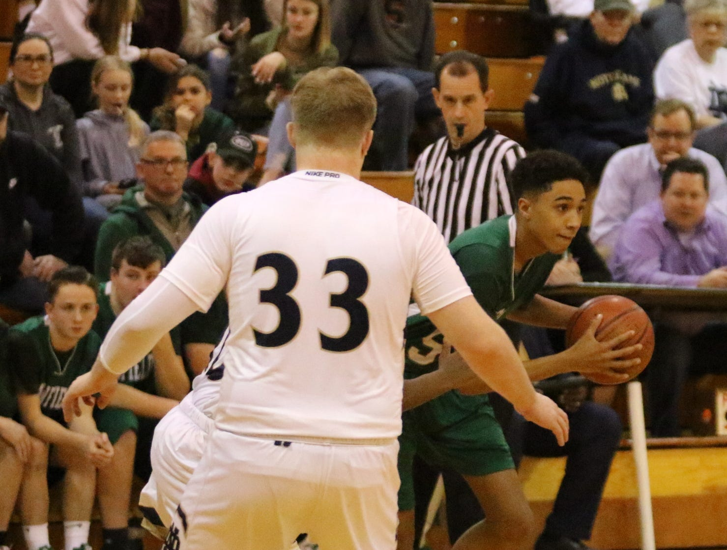 Action from Newfield at Elmira Notre Dame boys basketball Feb. 20, 2019 in Southport.