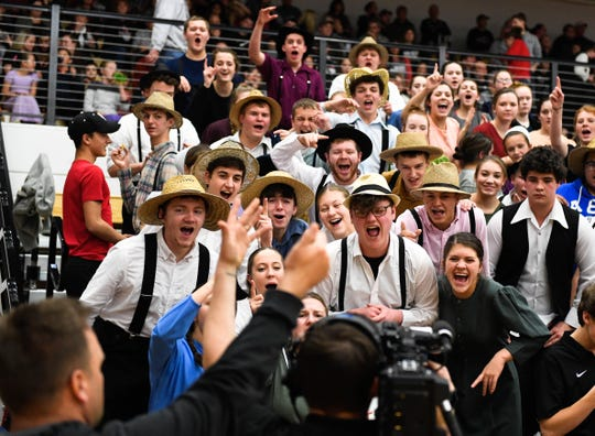 """The Barr-Reeve student section, in traditional Mennonite-Amish dress, mug for the camera during the regionally televised """"Buggy Bowl"""" as part of """"Basketball Day Indiana"""" on Fox Indiana Saturday, January 19, 2019."""