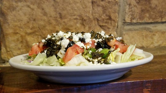 The Knob Hill Tavern's Greek Salad with refreshing mint dressing. We love it wrapped in soft flat pizza bread.