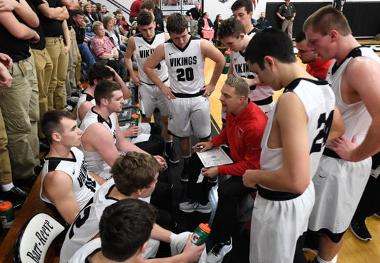Barr-Reeve Viking head coach Josh Thompson talks to his team during a timeout in a game with the Loogootee Lions Friday, January 11, 2019.
