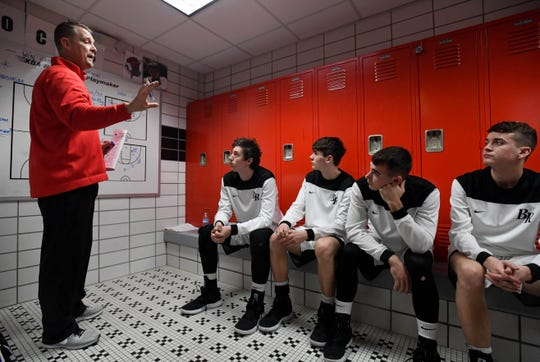 Barr-Reeve Viking head coach Josh Thompson goes over the game plan with his team before taking the court against the rival Loogootee. The Vikings face Bloomfield in the semistate on Saturday.