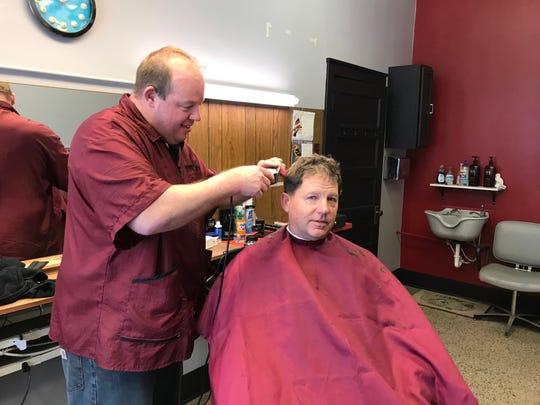 Wade Mostek cuts Dr. Steven Magoline's  hair Feb. 20 at Wade's Barbershop. Mostek opened the shop following the retirement of former owner, Bob Mueller.