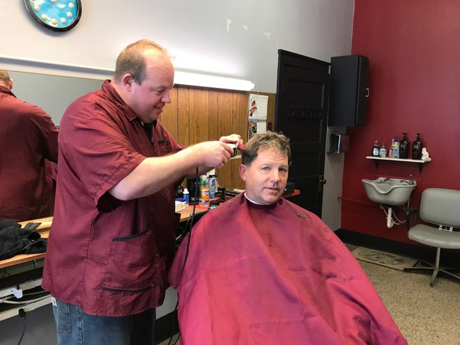 Wade Mostek cuts Dr. Steven Magoline's  hair Feb. 20 at Wade's Barbershop. Mostek opened the shop following the retirement of former owner, Bob Mueller.