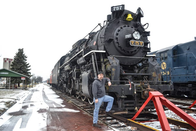 Dwayne Fuehring rests on no. 757, the locomotive his dad wanted to bring home to Bellevue until he died in 2006. Dwayne reignited the campaign in 2016, and the engine arrived in Bellevue on Feb. 14.