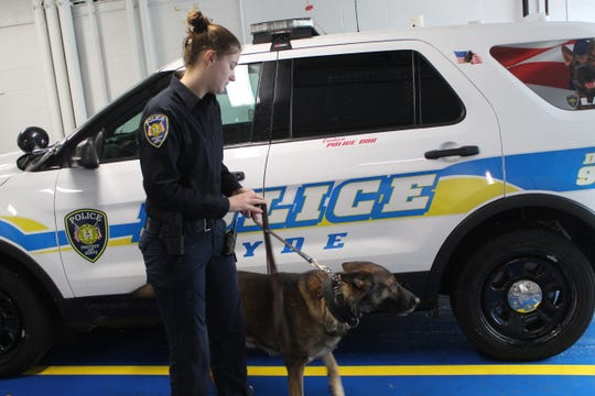 Carla Schaffer works with K-9 Lasso inside the Clyde Police garage.