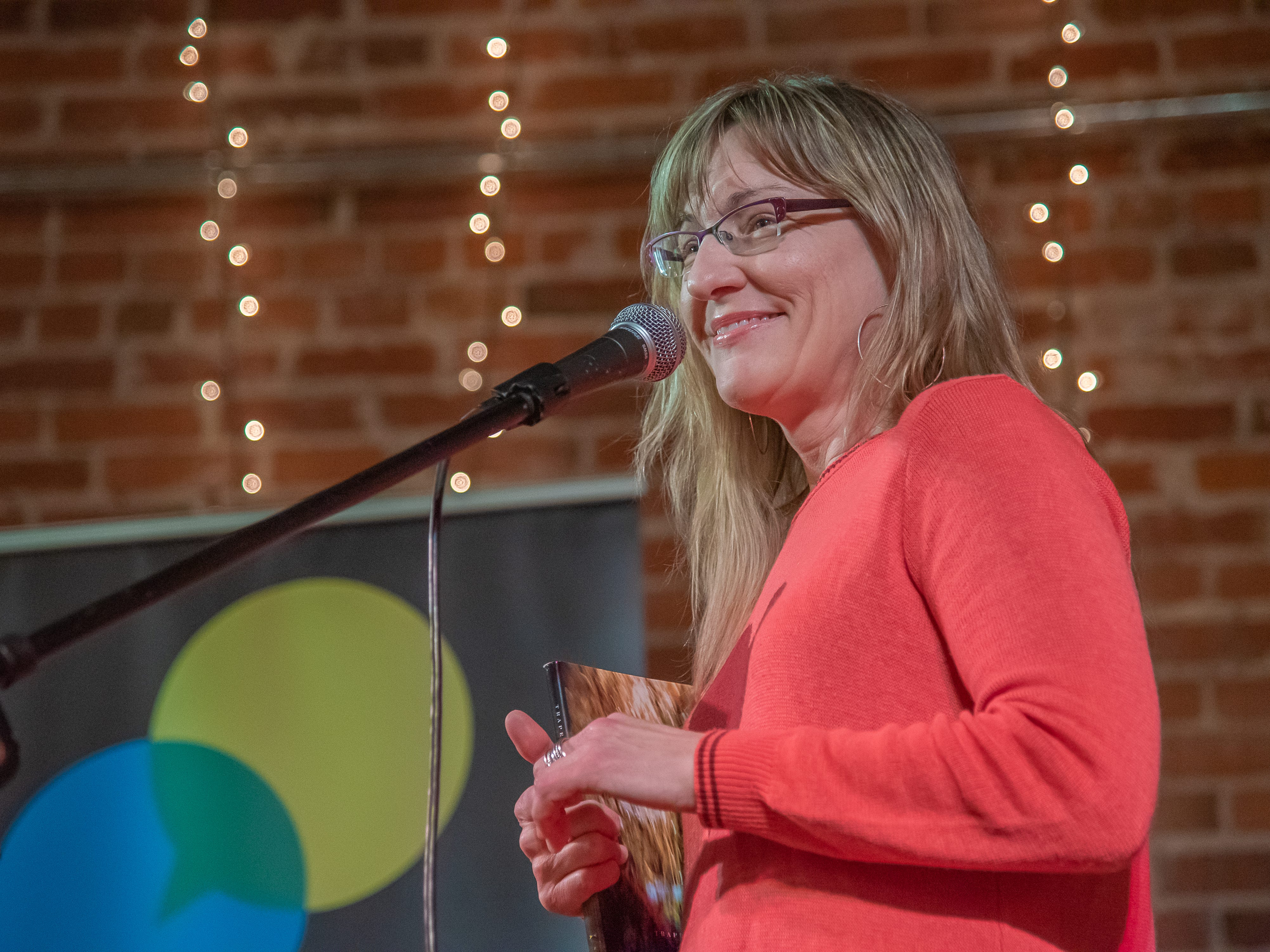 Storyteller Marj Hahne speaks of love and heartbreak during the Coloradoan Storytellers Project at Everyday Joe's Coffee House on Wednesday, February 20, 2019, in Fort Collins, Colo.