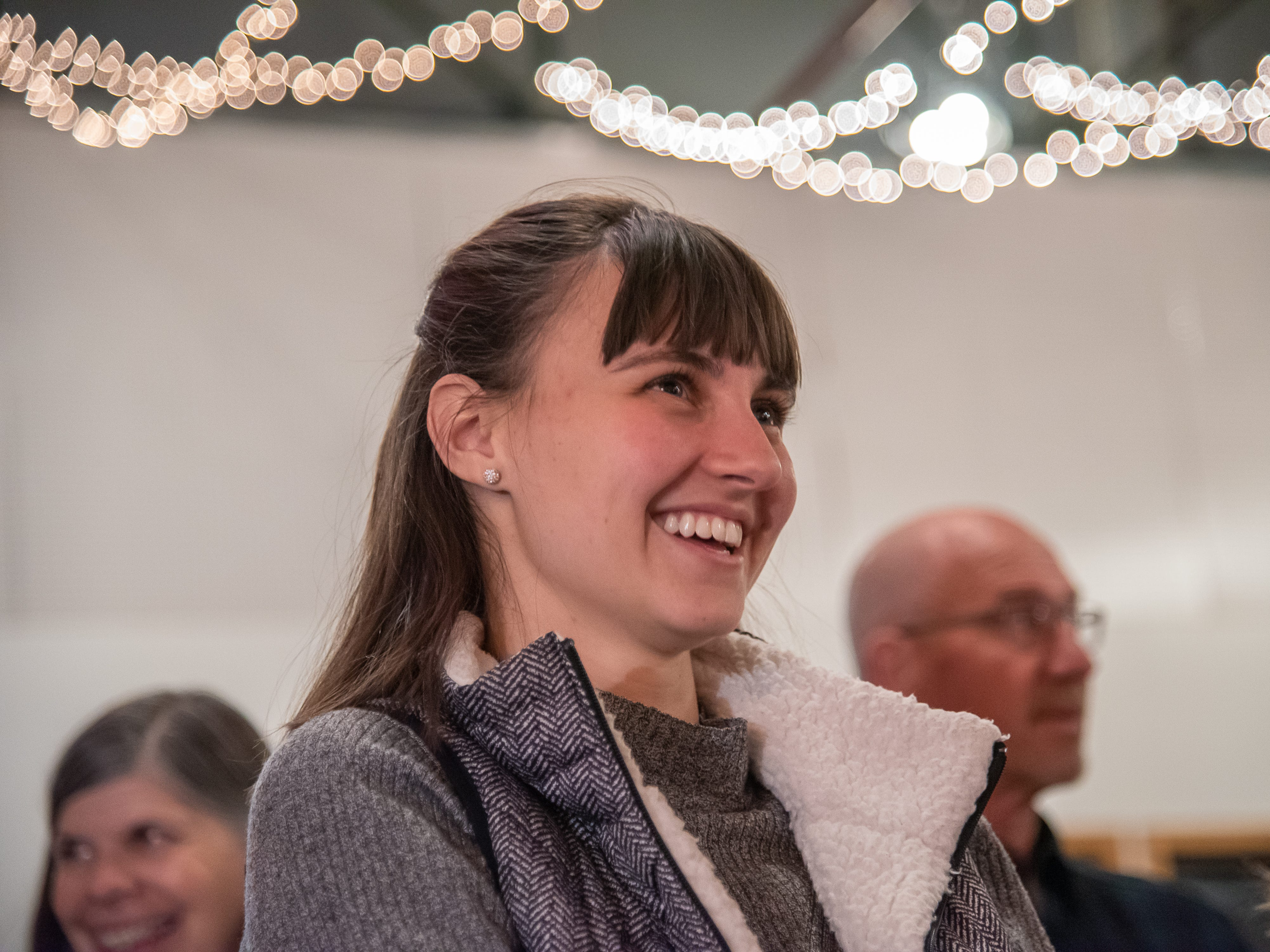 Audience member Nicole Bondy laughs  as a storyteller speaks of love and heartbreak during the Coloradoan Storytellers Project at Everyday Joe's Coffee House on Wednesday, February 20, 2019, in Fort Collins, Colo.