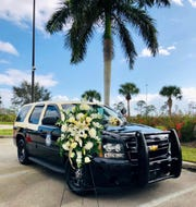 Florida Highway Patrol Master Sergeant Daniel Hinton's assigned vehicle on displayed in front of the Ft Myers FHP office. Hinton died Tuesday after suffering a cardiac arrest at a training exercise.