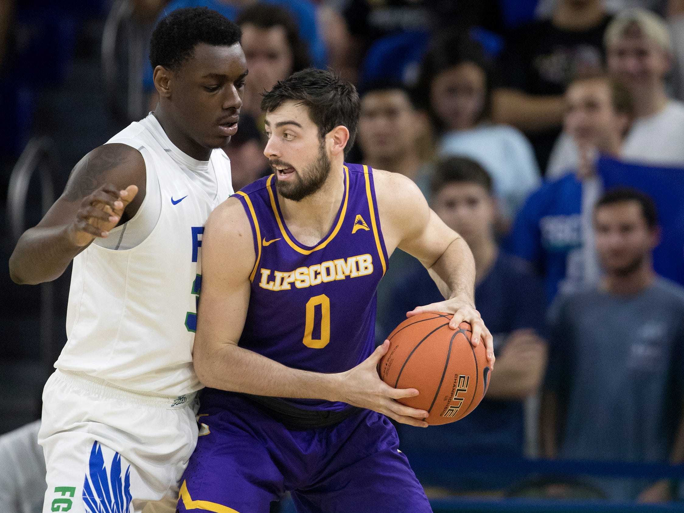 Lipscomb's Rob Marberry, right, drives to the basket against FGCU's Brian Thomas on Wednesday at FGCU in Fort Myers. FGCU beat Lipscomb 67-61.