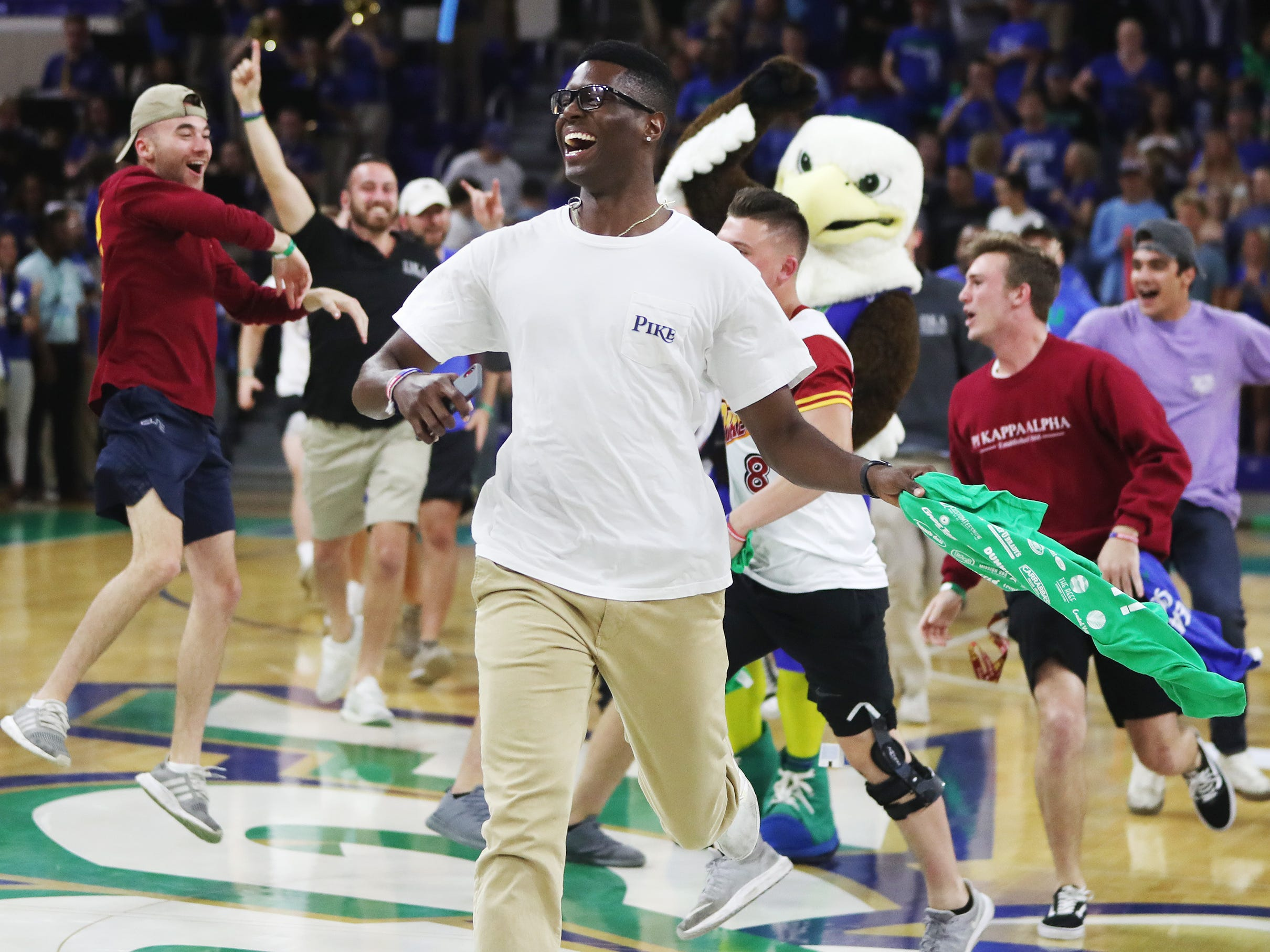Florida Gulf Coast University fans celebrate the men's basketball team beating Lipscomb on Wednesday at FGCU in Fort Myers. FGCU beat Lipscomb 67-61.