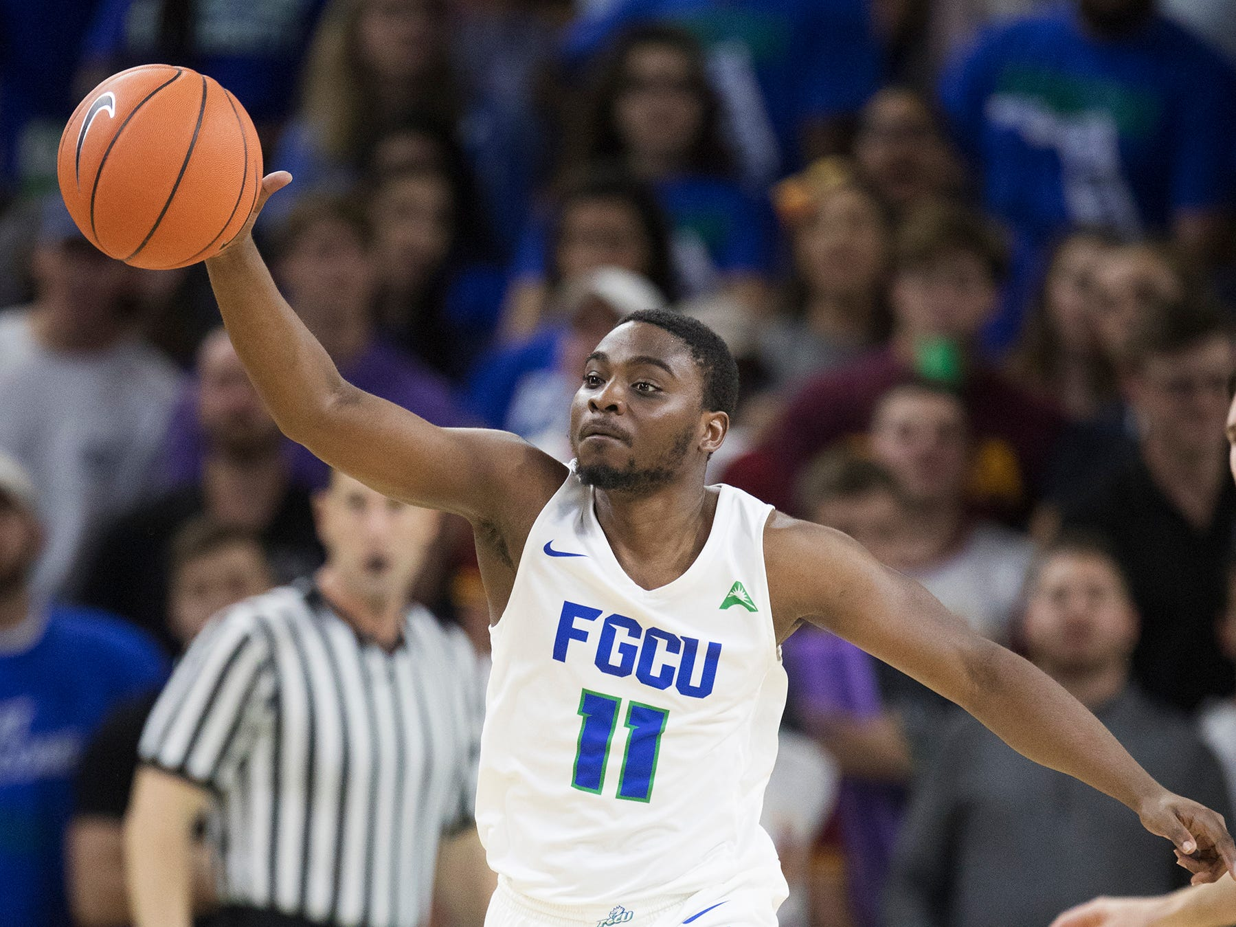 Florida Gulf Coast University's Schadrac Casimir leads a fast break against Lipscomb on Wednesday at FGCU in Fort Myers. FGCU beat Lipscomb 67-61.