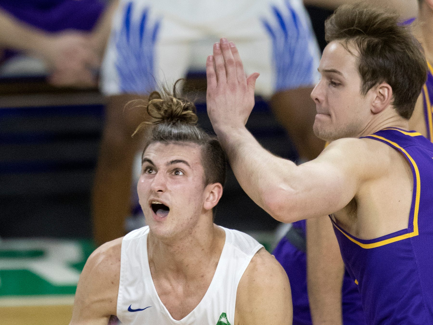 Florida Gulf Coast University's Caleb Catto drives to the basket against Lipscomb's Matt Rose on Wednesday at FGCU in Fort Myers. FGCU beat Lipscomb 67-61.
