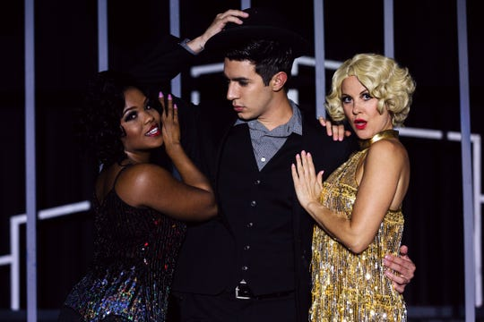 "The stars of Cultural Park Theatre's ""Chicago"" (left to right):  Angela Pierre as Velma, AJ Ford as Billy Flynn and Lisa Kuchinski as Roxie."