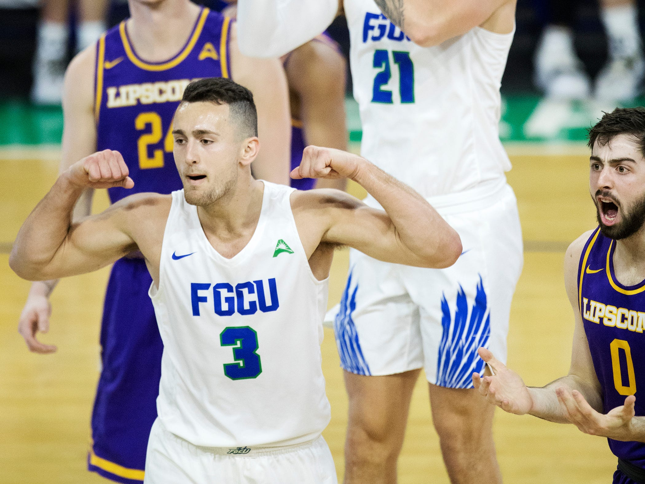 Florida Gulf Coast University's Christian Caryle celebrates scoring against Lipscomb recently at FGCU in Fort Myers. FGCU beat Lipscomb 67-61.