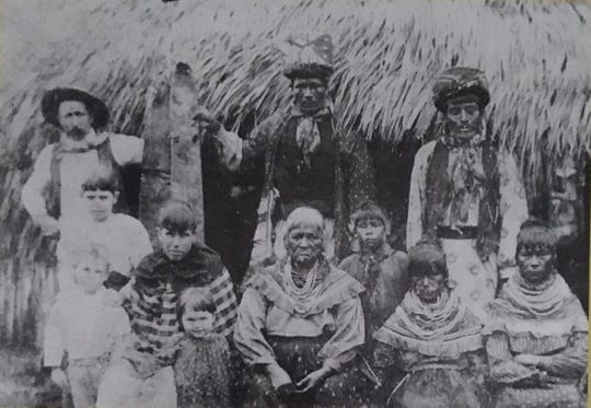 """Pictured with the Seminole are William H. """"Bill"""" Brown with his wife, Jane, and their three children."""
