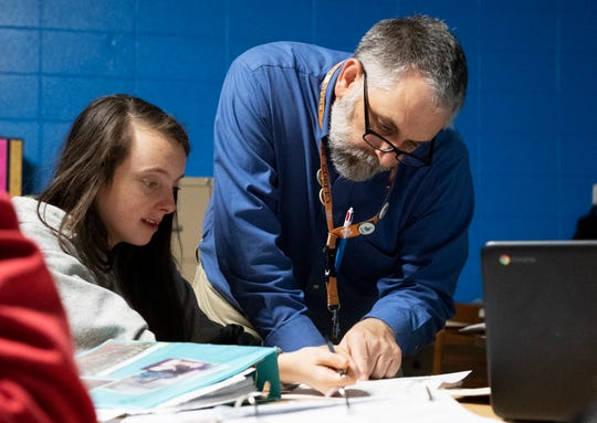 David James talks with Makayla Dill-Young, 14, at Northwest Middle School in Travelers Rest Thursday, Feb. 21, 2019. James has taught at the school for 21 years.