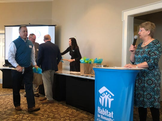 Greenville executives received hard hats, hammers, and  t-shirts during Thursday's kickoff  for Habitat for Humanity of Greenville County's 2019  CEO Build.