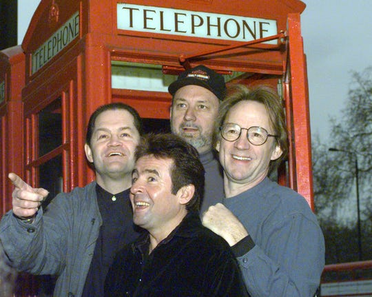Members of the pop group The Monkees pose in front of a telephone booth in London  Friday, January 10, 1997 following a press conference at the Hard Rock Cafe where they announced plans for all four members of the group  to begin touring for the first time in 30 years.  From left to right are Mickey Dolenz, Davy Jones, Mike Nesmith and Peter Tork.
