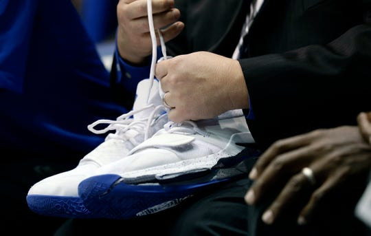 A trainer holds Duke's Zion Williamson's shoes after Williamson left the game due to an injury during the first half of an NCAA college basketball game against North Carolina in Durham, N.C., Wednesday, Feb. 20, 2019. Duke might have to figure out what the Zion Show will look like without its namesake. All because of a freak injury to arguably the most exciting player in college basketball. As his Nike shoe blew out, Williamson sprained his right knee on the first possession of what became top-ranked Duke's 88-72 loss to No. 8 North Carolina.