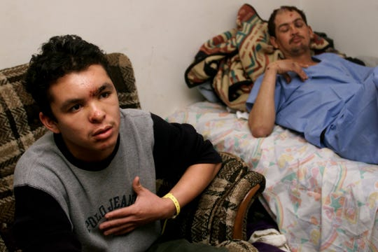 L to R Henry Jose Diaz talks on Feb. 14, 2000, about feeling the sheet on his body and trying to make enough noise so someone would hear him and realize he was in fact alive. Mario Rene Caballero, who was also in the accident, rests on a bed behind him.