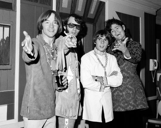 "FILE - This July 6, 1967 file photo shows the musical group, The Monkees, from left,  Peter Tork, Mike Nesmith, David Jones, and Micky Dolenz at a news conference at the Warwick Hotel in New York.The Monkees will perform its first live shows since its star Davy Jones died in February. Michael Nesmith, Micky Dolenz, and Peter Tork announced Wednesday, Aug. 8, 2012, that the group will launch a 12-date U.S. tour in November. Jones died of a heart attack on Feb. 29. The group starred in its own NBC television show in 1966 as a made-for-TV band seeking to capitalize on Beatlemania sweeping the world. Jones rocketed to the top of the music charts with The Monkees, captivating audiences with hits including ""Daydream Believer"" and ""I'm a Believer.""The tour kicks off Nov. 8 in Escondido, Calif. It wraps on Dec. 2 in New York. It will highlight Jones ""in the show's multimedia content."""