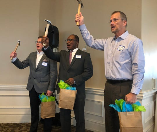 Greenville executives received gifts of hard hats, hammers, and  t-shirts during Thursday's kickoff  for Habitat for Humanity of Greenville County's 2019  CEO Build.