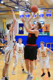 Roy-Winifred's Tyler Fordyce attempts a shot over a Belt defender during last week's District 8C tournament at Fergus High in Lewistown.
