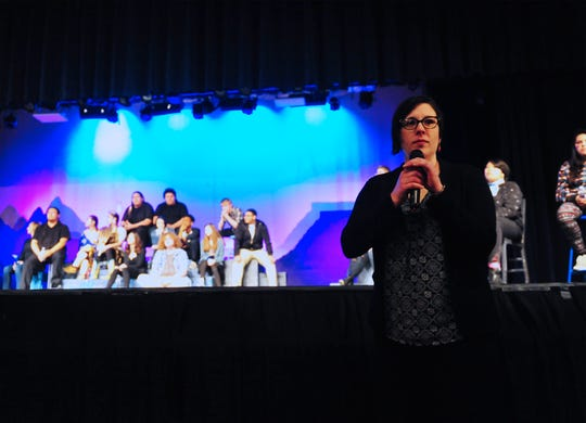 """Sarah Butts takes questions from the audience during a listening session at the end of the play, """"Converge: E Pluribus Unum,"""" which she wrote and directed for Great Falls Public Schools on Wednesday night at Great Falls High."""