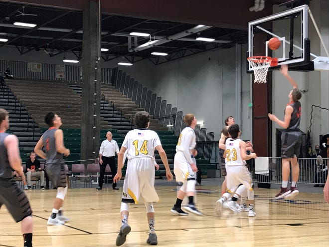 Sophomore Reese Elliot scores against Winnett-Grass Range Thursday afternoon at the Northern C combined tournament at Pacific Steel and Recycling Four Seasons Arena.
