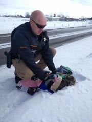 Cascade County deputy sheriff Jay Groskreutz assisted a distressed golden eagle on Thursday.