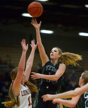 Tri-City's Chloe Derks shoots over Maci Malinario during the Northern C basketball tournament in the Four Seasons Arena on Wednesday afternoon.