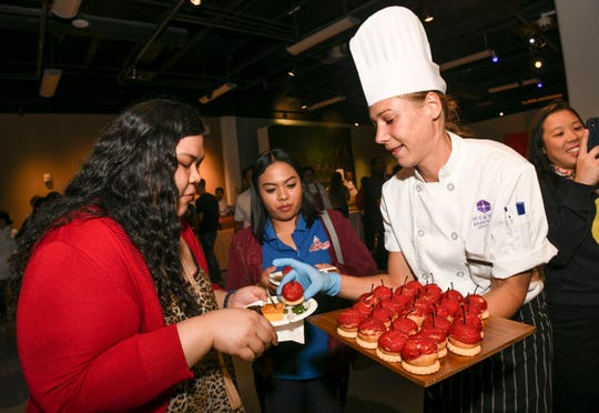 Patrons and culinary competitors filled an exhibit room at the Guam Museum for the 2019 Pastries in Paradise in this Feb. 21, 2019, file photo.