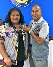 Guam Sunshine Lions Club member Lion Lorraine Rivera, left, second vice-president, was recently recognized by Lions Club International for being the liaison and sponsor of the newly formed Guam Un Guinaiya Branch Club. During the club's general membership meeting on Feb. 18 Lion President Pete Babauta presented her with the special pin from Lions Club International in recognition of her achievement and dedication to service.