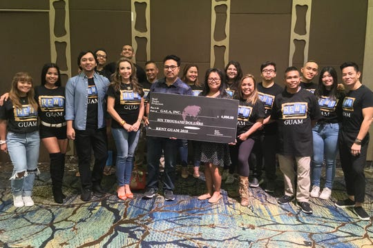 """World Theater Productions presented a $6,000 check to GALA from the proceeds of """"RENT Guam."""" The donation was made Jan. 24. Pictured from left: The cast of """"RENT Guam"""" Martin Estabillo, WTP marketing director; Shelly Calvo, WTP executive producer; Tim De La Cruz, executive director, GALA; Florecita Mesa, project assistant, GALA; Margie Dancel, WTP executive producer & choreographer; Maximo Ronquillo, Jr., WTP musical director, and Jojo Urquico, WTP artistic director."""