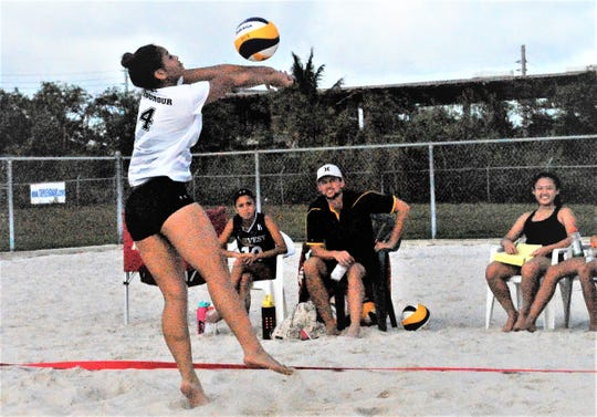 Tiyan Titans Ajia Fegurgur reaches to pass the ball to her partner Yaya Jorda during IIAAG Beach Volleyball on Feb. 2.