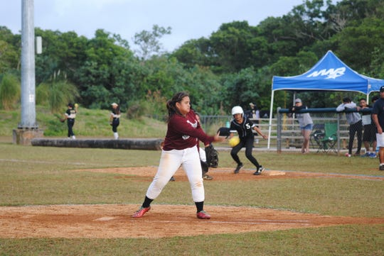 Okkkodo High School Bulldogs pitcher Jeaveha Toves lets a pitch fly against Simon Sanchez High School in the fifth inning of their IIAAG High School Girls Softball game Feb.20 at Okkodo. The Sharks won 14-4 in 5 innings to earn their third win. Okkodo remains winless at 0-9.