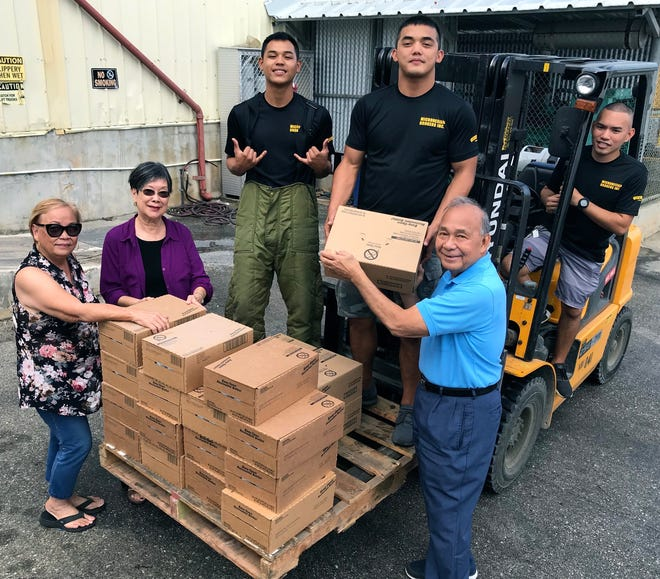 The Guam Sunshine Lions Club received a donation of 15 cases of Ensure and 5 cases of Glucerna nutrition products from Micronesian Brokers, Inc. on Feb. 19, which will be distributed to needy individuals. Shown receiving the items on ground level from left: Lions Jill Pangelinan, Marietta Camacho, and Pete Babauta. On the forklift from left:  Micronesian Brokers, Inc. employees Shane Siguenza, Ronnie Blas, and Jesse Cruz.