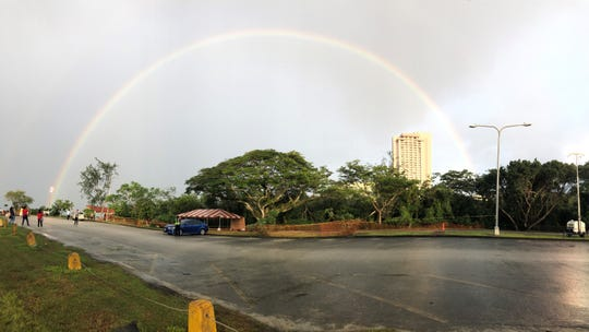 Photo of rainbow over Ypao Beach in 2018.