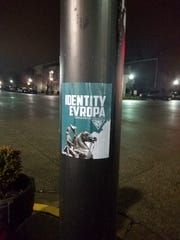 A poster for a white-supremacist hate group is posted on a traffic signal pole in downtown Henderson recently.