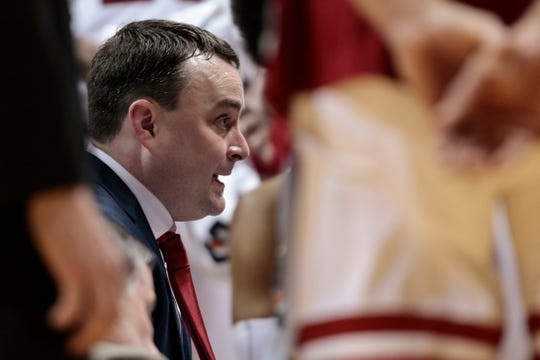 Indiana coach Archie Miller talks with his team during a timeout in Tuesday in a game against Purdue. Purdue won 48-46. (AP Photo/AJ Mast)