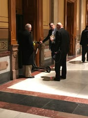 Rep. Sean Eberhart, R-Shelbyville, holds a Bird scooter in a hallway in the Indiana Statehouse while speaking to Rep. Chuck Moseley, D-Portage, and Rep. Tim Brown, R-Crawfordsville. Rep. Eberhart sponsored a bill that looked to define electric scooters in state law.