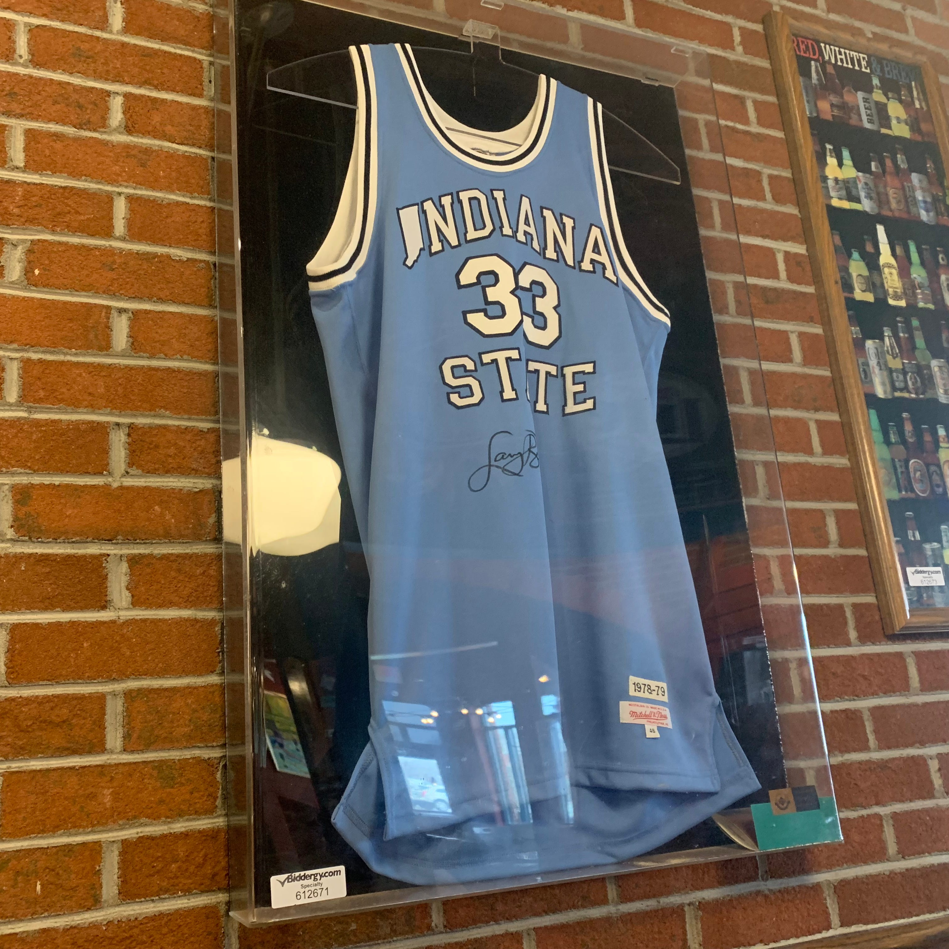 A Larry Bird autographed Indiana State Jersey is...