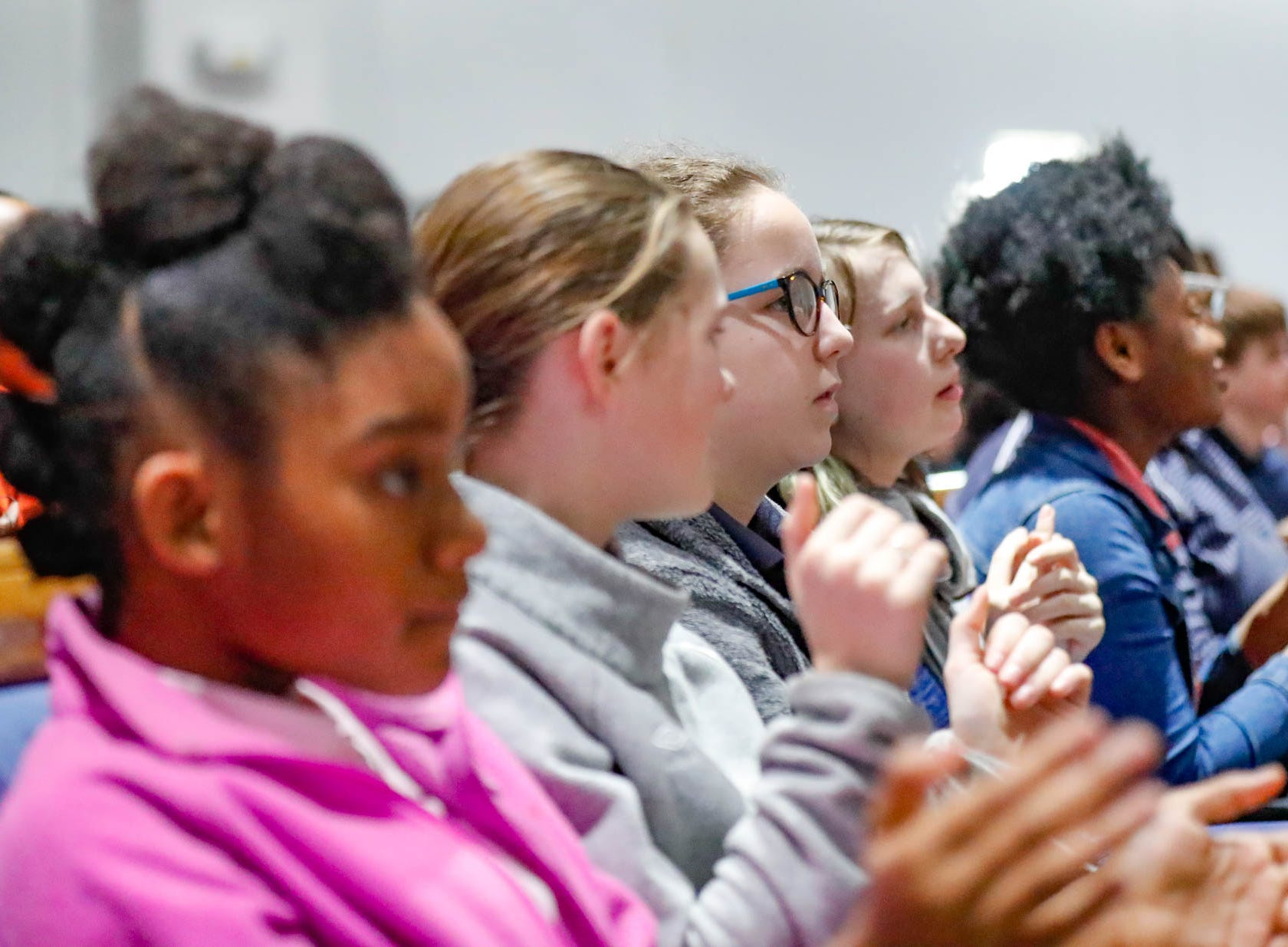 """School children sing and dance to the Tri-City School Gospel Choir during the annual Steward Speakers Lecture Series event, held at Olivet Missionary Baptist Church in Indianapolis on Thursday, Feb. 21, 2019. This years theme was """"Year of the woman""""."""