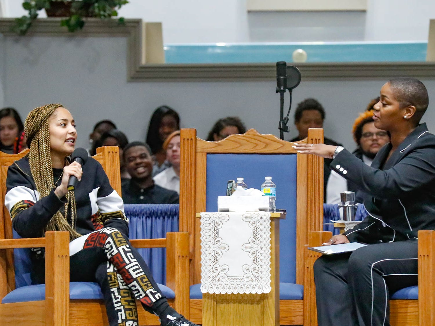 """American comedian, actress, disc jockey (DJ), recording artist and radio personality, Amanda Seales, left, and Section Chief of OFAN, Courtney Mack, right, have a frank discussion for children during the annual Steward Speakers Lecture Series event, held at Olivet Missionary Baptist Church in Indianapolis on Thursday, Feb. 21, 2019. This years theme was """"Year of the woman""""."""
