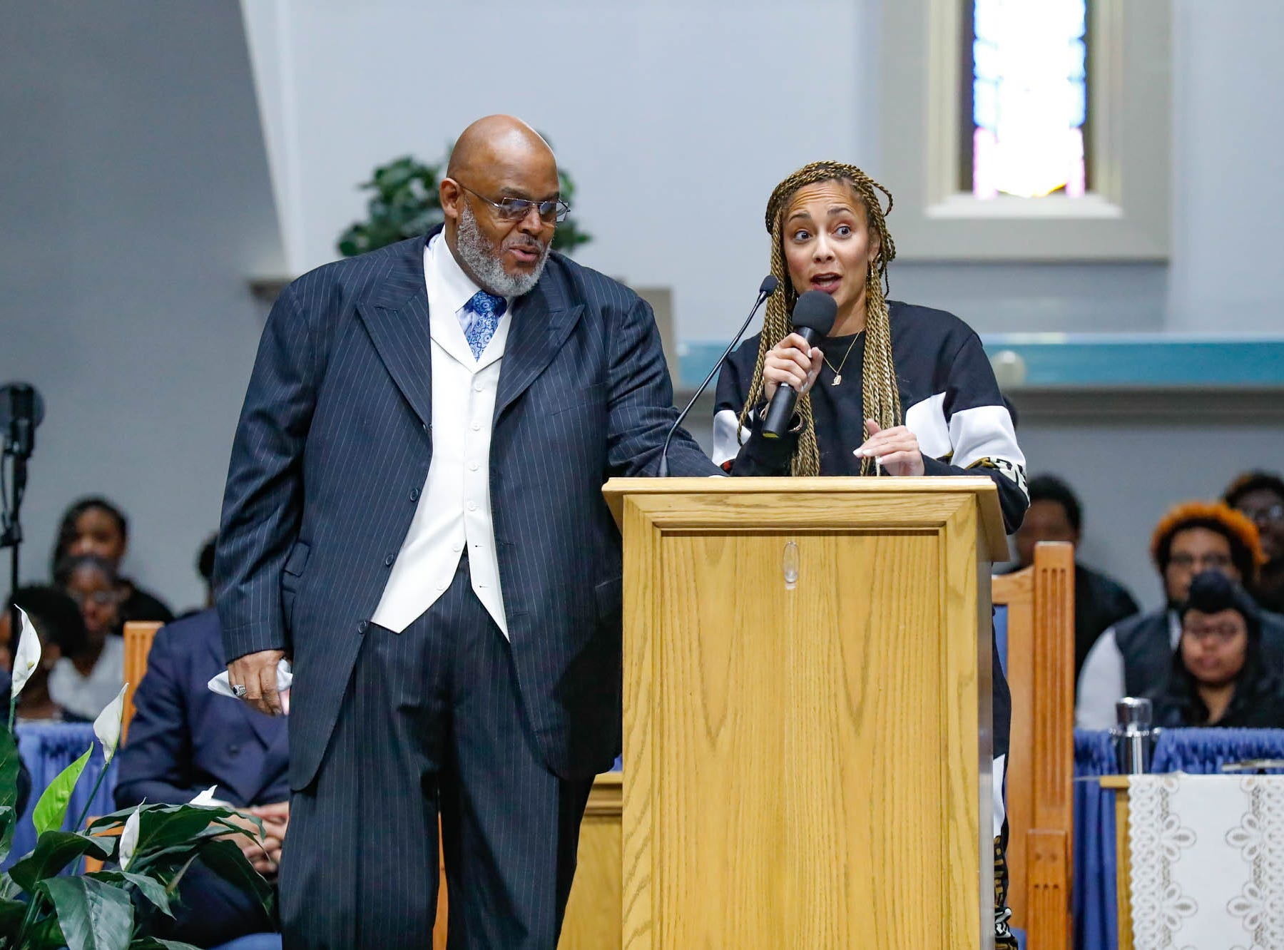 """Rev. Dr. Wayne Moore, left,  introduces keynote speaker and American comedian, actress, disc jockey (DJ), recording artist and radio personality, Amanda Seales, during the annual Steward Speakers Lecture Series event, held at Olivet Missionary Baptist Church in Indianapolis on Thursday, Feb. 21, 2019. This years theme was """"Year of the woman""""."""