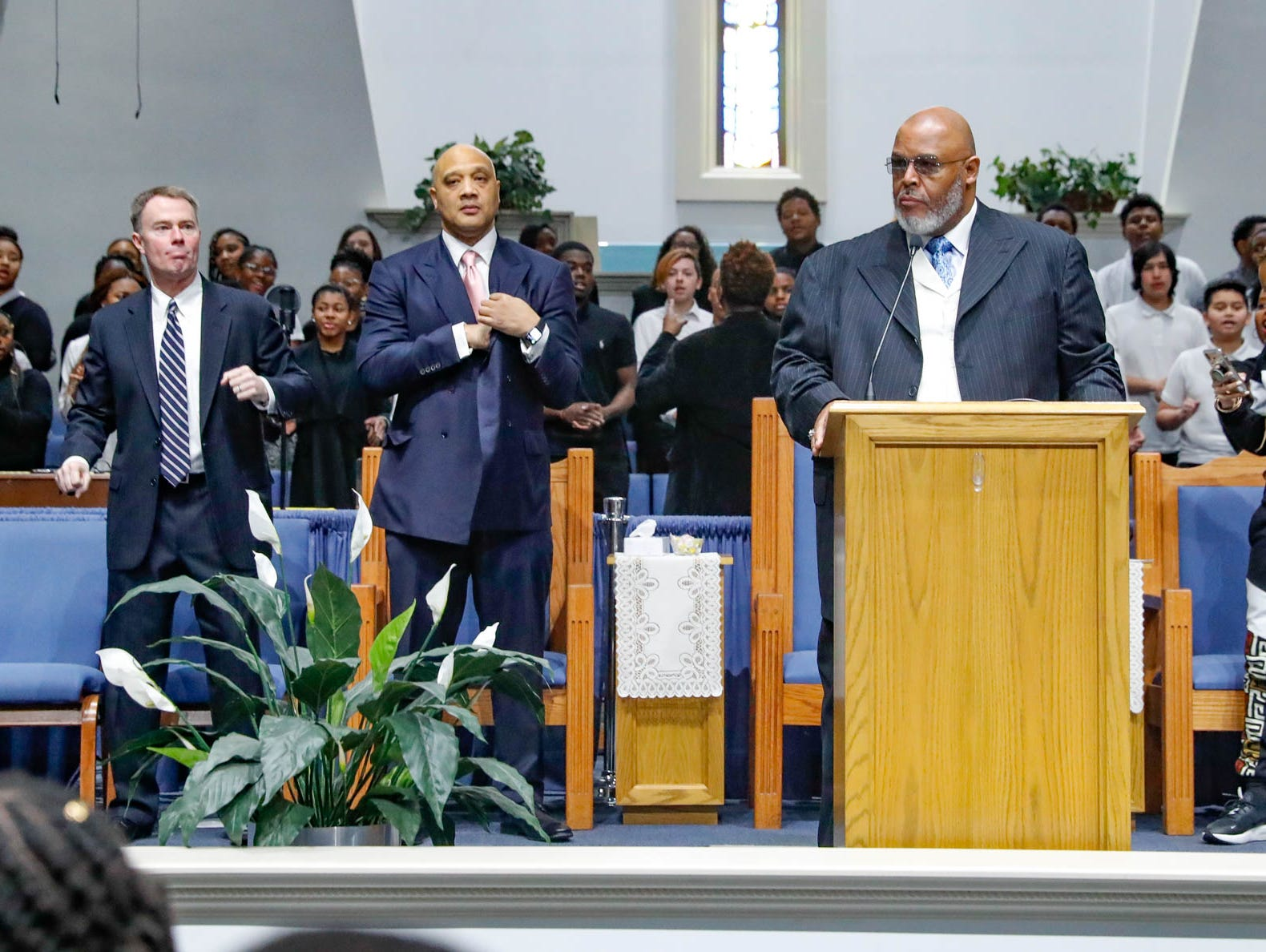 """Rev. Dr. Wayne Moore greets guests during the annual Steward Speakers Lecture Series event, held at Olivet Missionary Baptist Church in Indianapolis on Thursday, Feb. 21, 2019. This years theme was """"Year of the woman"""". Left, Indianapolis Mayor Joe Hogsett, center left, U.S. Representative AndrŽ Carson."""